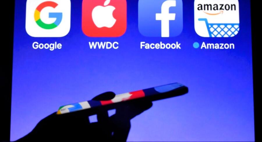 Imperierne kaldes populært GAFA: Google, Apple, Facebook og Amazon. Foto: Damien Meyer/Ritzau Scanpix
