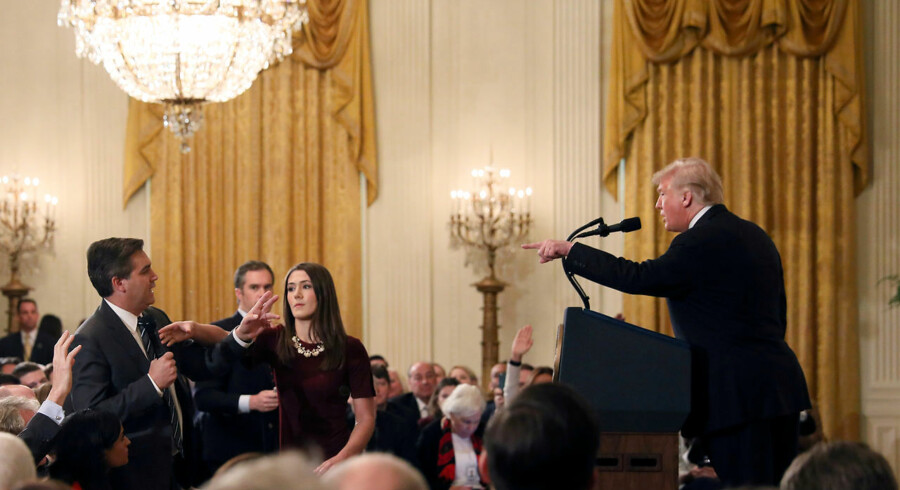 FILE PHOTO: A White House staff member reaches for the microphone held by CNN's Jim Acosta as he questions U.S. President Donald Trump during a news conference following Tuesday's midterm U.S. congressional elections at the White House in Washington, U.S., November 7, 2018. REUTERS/Jonathan Ernst/File Photo