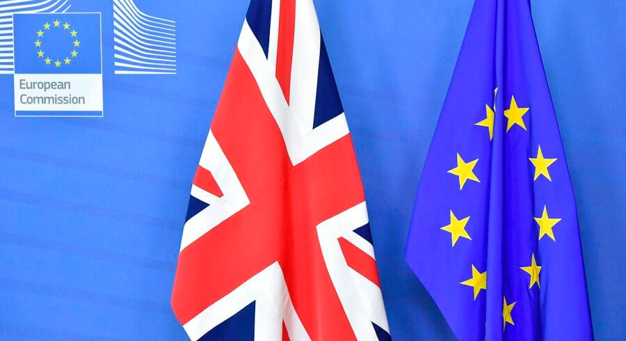 """(FILES) In this file photo taken on October 17, 2018 the United Kingdom (Union) flag and the European Union (EU) are pictured before the arrival of Britain's Prime Minister Theresa May and President of the European Commission Jean-Claude Juncker at the European Commission in Brussels. - The EU and Britain agreed on November 22, 2018, a draft declaration on their post-Brexit relations that sets out an """"ambitious, broad, deep and flexible partnership, """" officials said. European Council President Donald Tusk said the EU executive informed him it has agreed the political declaration on the future relationship with Britain. (Photo by EMMANUEL DUNAND / AFP)"""