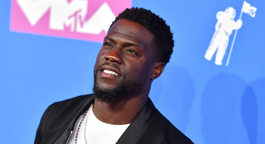 (FILES) In this file photo taken on August 20, 2018 US actor/comedian Kevin Hart attends the 2018 MTV Video Music Awards at Radio City Music Hall on August 20, 2018 in New York City. - US comedian and actor Kevin Hart announced on December 4, 2018, that he would be hosting the 91st Academy Awards in February. (Photo by ANGELA WEISS / AFP)