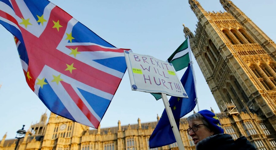 Anti-Brexit activists protest outside the Houses of Parliament in London on December 11, 2018. - British Prime Minister Theresa May began a humiliating European tour on Tuesday in a desperate bid to salvage her Brexit deal, a day after delaying a parliamentary vote on the text to avoid a crushing defeat. (Photo by Tolga AKMEN / AFP)