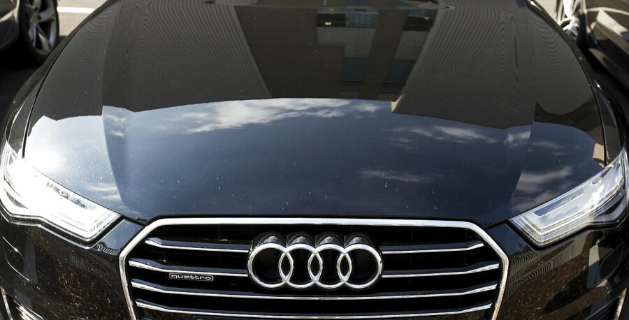 The Audi powerplant is reflected in an Audi Quattro in Brussels, Belgium September 28, 2015. Volkswagen, facing a scandal for the falsification of U.S. emissions tests has said 11 million cars worldwide had defeat devices installed, including 2.1 million of Audi of models A1, A3, A4, A5, A6, TT, Q3 and Q5. REUTERS/Yves Herman