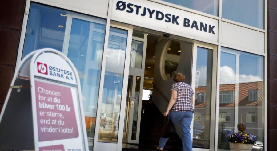 """Østjydsk Bank kommer ud af første kvartal med et underskud på 318 millioner kroner før skat. Banken skal hente 175 millioner for at overleve. Ledelsen i banken betegner resultatet som """"stærkt utilfredsstillende"""". (se Ritzau historie 310838) (Foto: Lars Rasborg/Scanpix 2013)"""