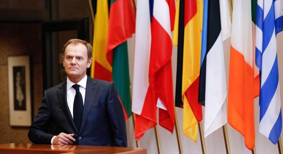 Formand for Det Europæiske Råd Donald Tusk venter på Ukraines premierminister Arseniy Yatsenyuk forud for et møde i Bruxelles.