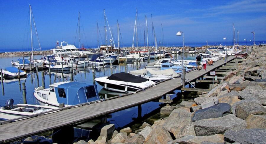 Også ejerskabet af en båd, der ligger i dansk havn, kan blive problematisk for udlandsdanskere, hvis båden har størrelsen og indretningen til at være egnet til helårsbeboelse. Billedet er fra Hornbæk Havn. Foto: Flickr/Guillaume Baviere
