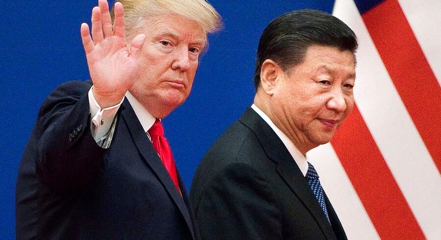 Handelskrigen mellem USA og Kina har sat sit præg på kinesiske aktier, der indtager pladsen som årets dårligste aktiemarked. Arkivfoto: AFP/Nicolas Asfouri/Ritzau Scanpix