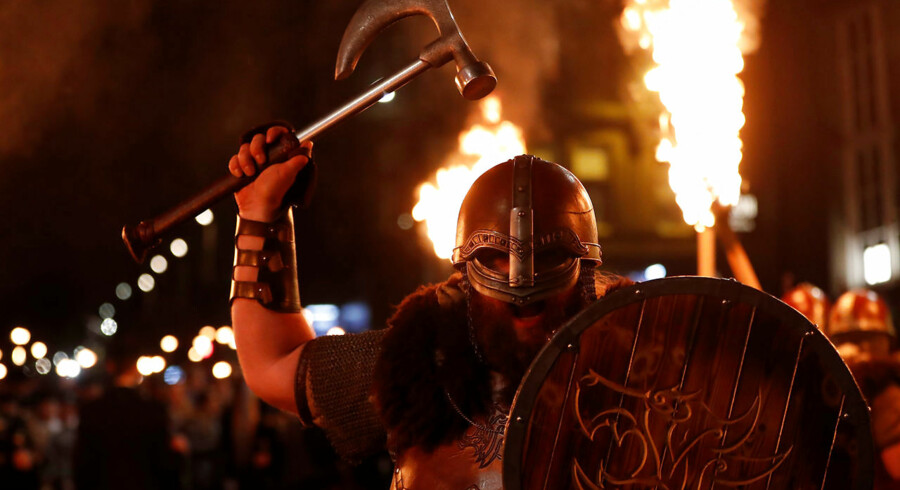 Up Helly Aa vikings from the Shetland Islands hold axes and lit torches during the annual torchlight procession to mark the start of Hogmanay (New Year) celebrations in Edinburgh, Scotland December 30, 2017. REUTERS/Russell Cheyne