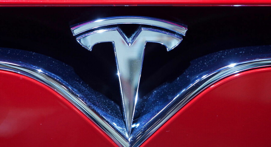 epa07297037 (FILE) - A Tesla logo seen at the Paris Motor Show 'Mondial de l'Automobile' in Paris, France, 30 September 2016 (reissued 18 January 2019). Tesla on 18 January 2019 said it plans to cut some 7 per cent of its full-time workforce as part of cost reduction efforts. Tesla also said the 4th quarter 2018 profits would be lower than those of 3rd quarter 2018. EPA/IAN LANGSDON