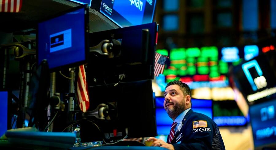 Det var en spændende uge på finansmarkederne. Den amerikanske centralbank gav efter og agerede redningsplanke for aktier globalt. Foto: Johannes Eisele/AFP/Ritzau Scanpix