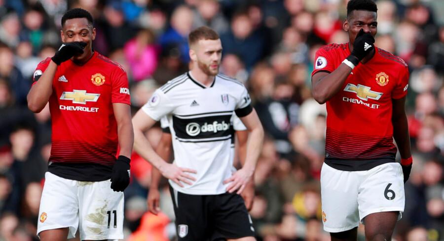 Anthony Martial (til venstre) og Paul Pogba sparkede Manchester United til sejr over Fulham. Andrew Couldridge/Ritzau Scanpix