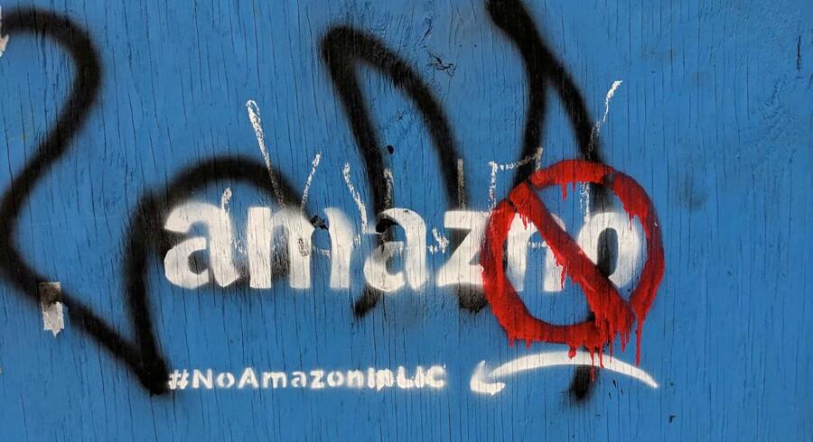 En graffitikunstners budskab til internetgiganten, der vil rykke ind i Long Island City i New York. Arkivfoto: Nandita Bose, Reuters/Ritzau Scanpix
