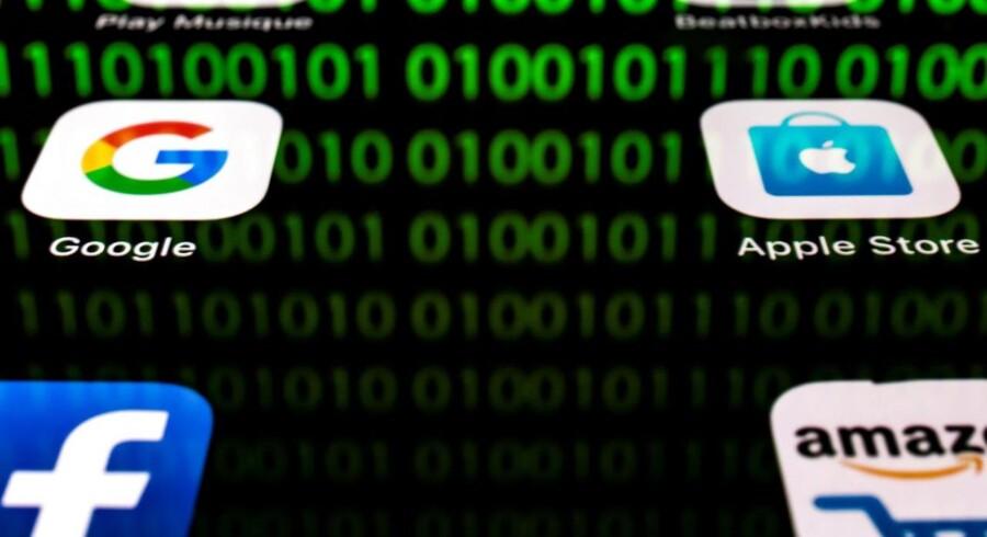 IT-giganterne har fået for stor magt, mener stadig flere myndigheder, som derfor opruster for at kunne holde trit med og granske dem. Arkivfoto: Lionel Bonaventure, AFP/Ritzau Scanpix