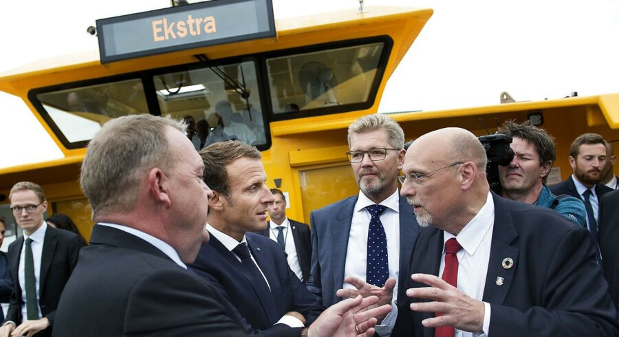 Realdanias topchef, Jesper Nygård (til højre med rødt slips), i samtale med den franske præsident, Emmanuel Macron (nr. to fra venstre), mens statsminister Lars Løkke Rasmussen og Københavns overborgmester, Frank Jensen, lytter under Macrons officielle statsbesøg i august 2018.