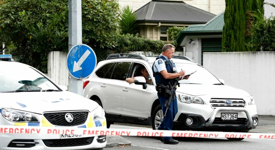 A police officer cordons off the area close to the Masjid al Noor mosque after a shooting incident in Christchurch on March 15, 2019. - Attacks on two Christchurch mosques left at least 40 dead on March 15, with one gunman - identified as an Australian extremist - - apparently livestreaming the assault that triggered the lockdown of the New Zealand city. (Photo by Tessa BURROWS / AFP)