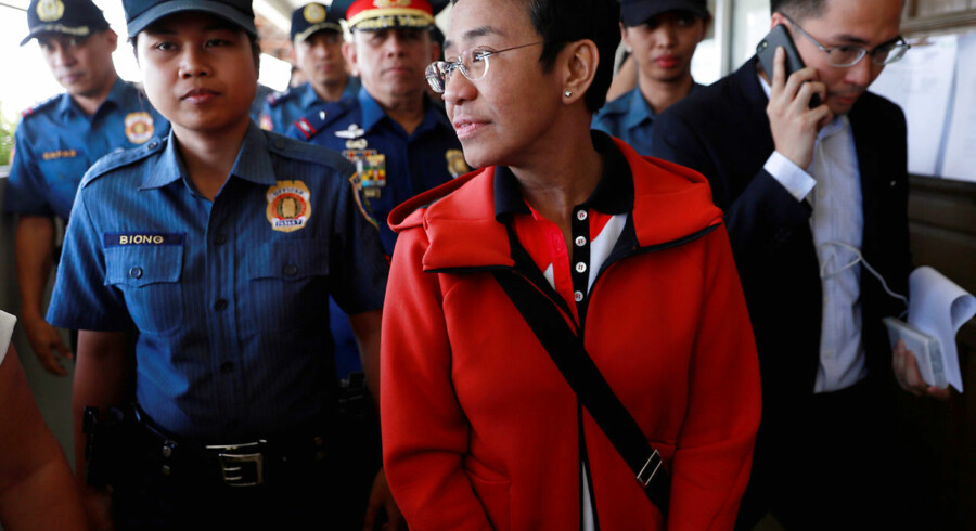 Rappler CEO and Executive Editor Maria Ressa is escorted by police after posting bail in Pasig Regional Trial Court in Pasig City, Philippines, March 29, 2019. REUTERS/Eloisa Lopez
