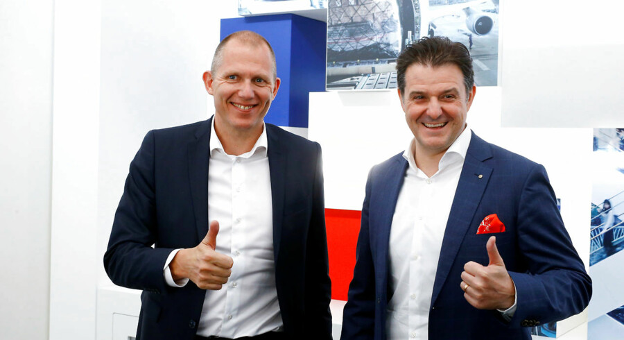 CEO Jens Bjoern Andersen of DSV and CEO Stefan Karlen (R) of Panalpina pose for the media after a news conference at the Panalpina headquarters in Basel, Switzerland April 1, 2019. REUTERS/Arnd Wiegmann