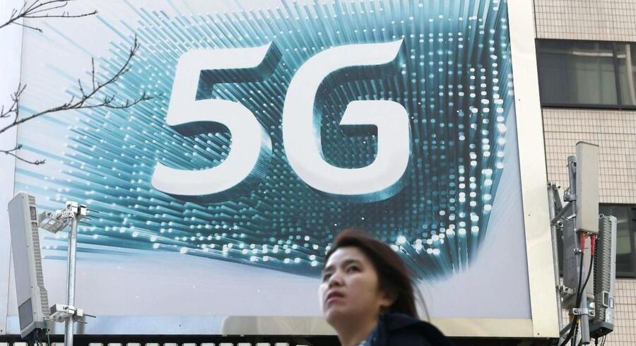 5G skal hurtigt ud og i brug i Norge. Derfor ændrer den norske regering på, hvor hurtigt teleselskaberne skal betale for mobilfrekvenserne. Arkivfoto: Yeon-Je Jung, AFP/Ritzau Scanpix