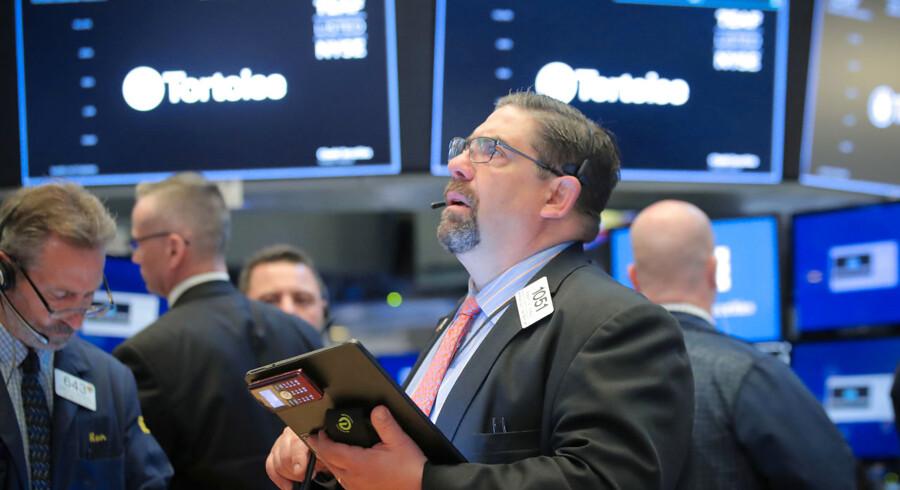 Børsmæglere på arbejde på New York Stock Exchange.