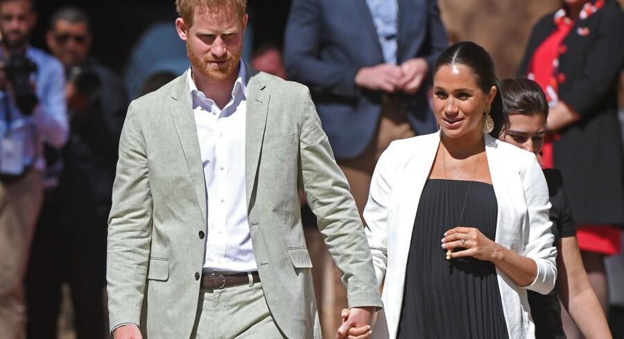 En gravid Megan Markle og prins Harry.