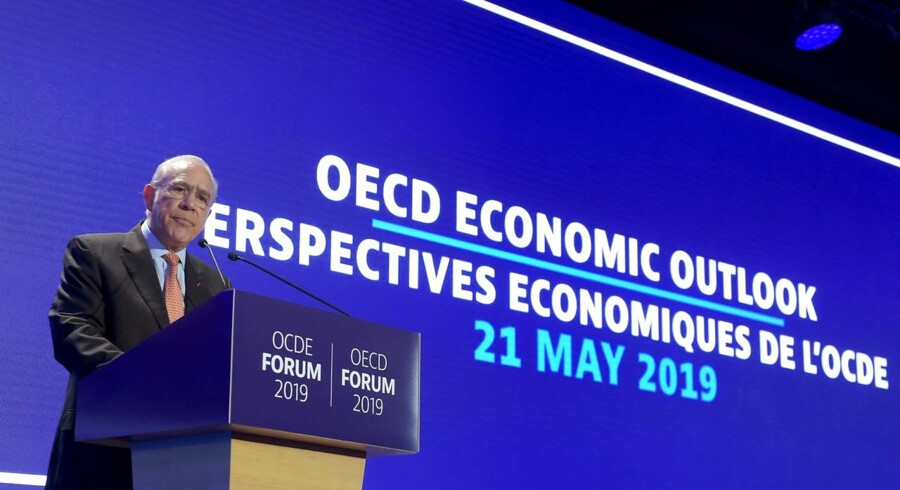 Angel Gurria, General Secretary of the Organisation for Economic Co-operation and Development (OECD), delivers a speech as he presents the OECD Economic Outlook at the OECD headquarters in Paris on May 21, 2019. - Global trade tensions and political uncertainty are weighing on the world's economy, the OECD warned on May 21, 2019, cutting its global growth forecast for this year to 3.3 percent, down from the 3.5 percent it predicted in November. (Photo by ERIC PIERMONT / AFP)