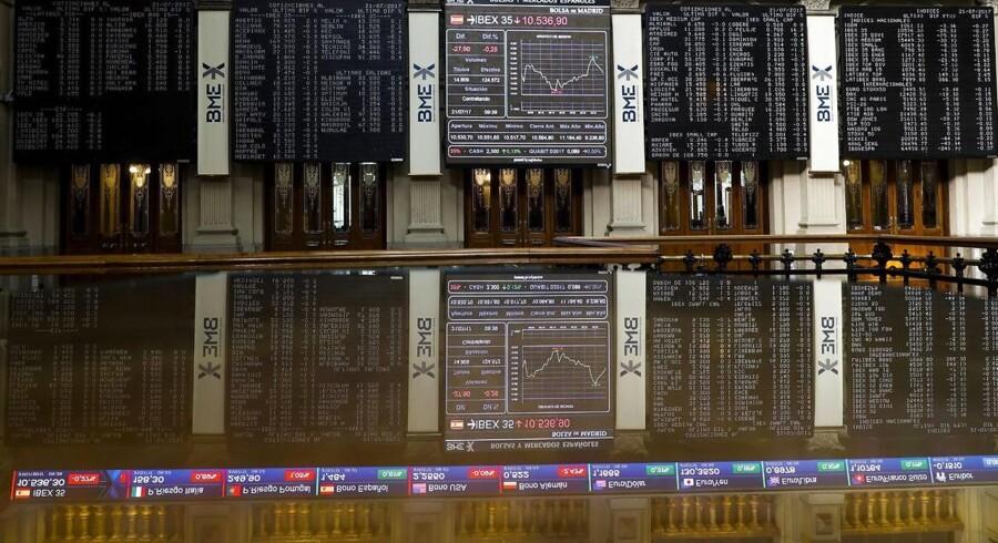 Arkivfoto. Bunker af regnskaber vælter ind over de amerikanske investorer tirsdag, hvor stemningen op til børsåbningen virker ganske god.
