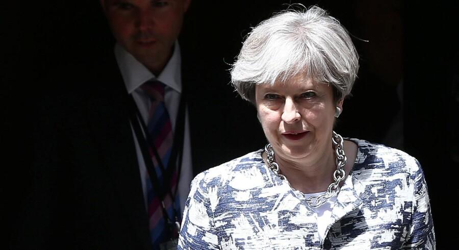 - Vi vil tilbyde sikkerhed for de tre millioner EU-borgere, der bor i Storbritannien, siger premierminister Theresa May i parlamentet. Reuters/Neil Hall