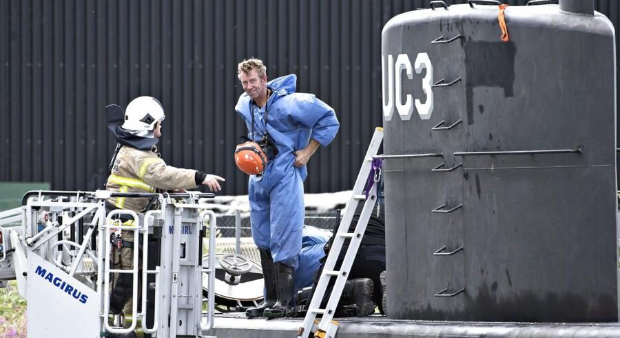 Tekniske undersøgelser af ubåden UC3 Nautilus søndag 13. august 2017 ved ØTC Costing Yard ved Nordsøvej i Københavns Nordhavn. Ubådens ejer Peter Madsen er sigtet for uagtsomt manddrab og varetægtsfængslet i 24 dage, efter at torsdagens passager på ubåden, den svenske journalist Kim Wall, stadig ikke er fundet. (Foto: Jens Nørgaard Larsen/Scanpix 2017)