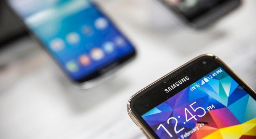 Samsung gør klar til at lancere sin egen mobilbetaling, som umiddelbart kan bruges langt bredere end Apples. Arkivfoto: Andrew Burton, Getty Images/AFP/Scanpix