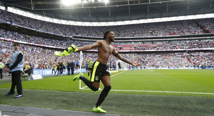 "Britain Football Soccer - Reading v Huddersfield Town - Sky Bet Championship Play-Off Final - Wembley Stadium, London, England - 29/5/17 Huddersfield Town's Kasey Palmer celebrates after winning the penalty shootout and getting promoted to the Premier League Action Images via Reuters / Matthew Childs Livepic EDITORIAL USE ONLY.No use with unauthorized audio, video, data, fixture lists, club/league logos or ""live"" services. Online in-match use limited to 45 images, no video emulation.No use in betting, games or single club/league/player publications. Please contact your account representative for further details."