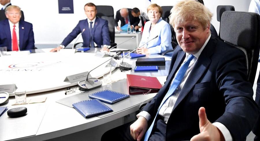 Vesten er stadig ved at fordøje, hvor meget verdenspolitikken er blevet forandret de sidste fem år. Globaliseringen, og dermed ideen om at resten af verden automatisk var ved at blive ligesom os, er ikke længere en dækkende beskrivelse af, hvor historien går hen. Her ses Donald Trump, Emmanuel Macron, Angela Merkel og Boris Johnson under G7-topmødet 26. august.