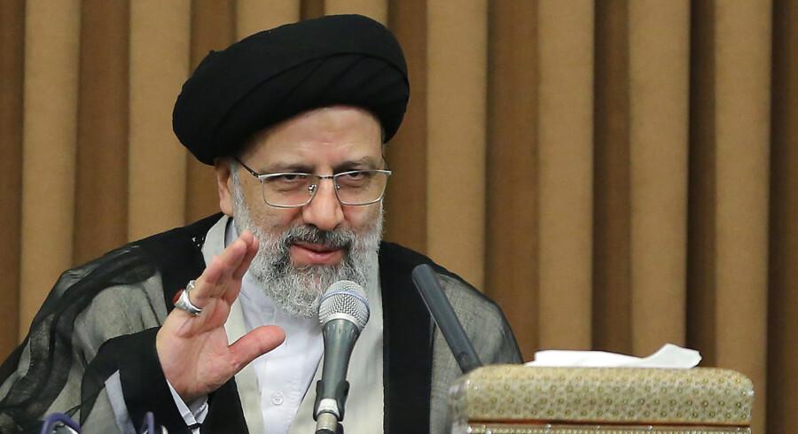 En iransk hackergruppe med forbindelser til præstestyret – på billedet Irans præsident, Hassan Rouhani – har ifølge Microsoft forsøgt at angribe en amerikansk præsidentkandidats valgkampagne. Cyberangreb fra statsstøttede hackere udgør et stigende problem for vestlige regeringer.