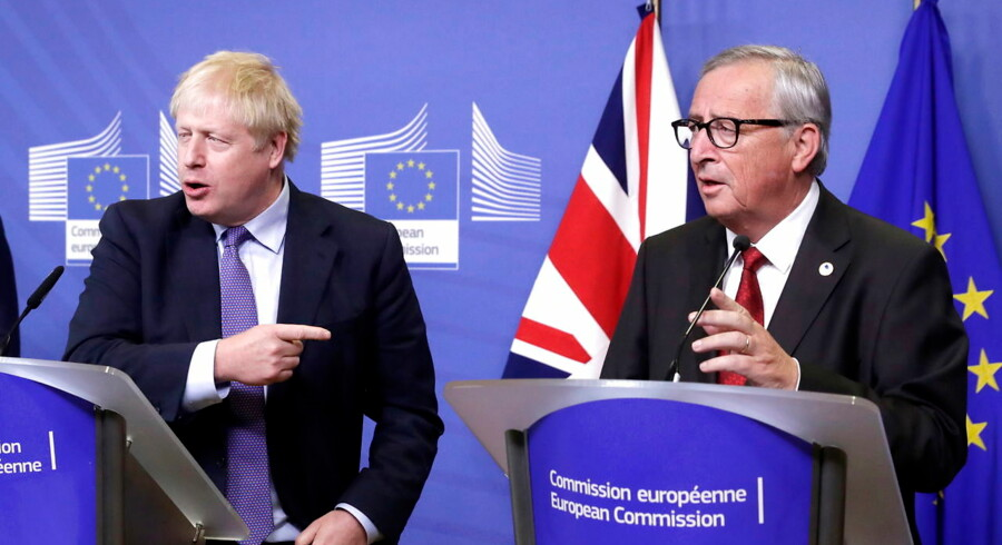 epa07927440 President of the European Comission Jean-Claude Juncker (R) and British Prime Minister Boris Johnson deliver a press conference on the Brexit deal in Brussels, Belgium, 17 October 2019. According to reports, the EU and the British government have reached a deal for Brexit. EPA/STEPHANIE LECOCQ