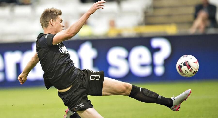 Selv om flere danske fodboldklubber stadig bløder på bundlinjen, kan klubberne gå lysere tider i møde med små overskud. Arkivfoto.