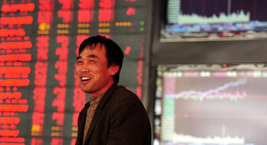 Der er godt nyt for de finansielle markeder fra verdens næststørste økonomi, mener økonomerne oven på en opgørelse over Kinas vækst. (AFP PHOTO CHINA OUT).
