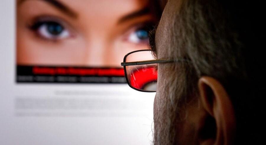 Hackere har afsløret navnene på millioner af brugere på det store dating-site for utroskab, Ashley Madison. Foto: Eva Hambach/AFP