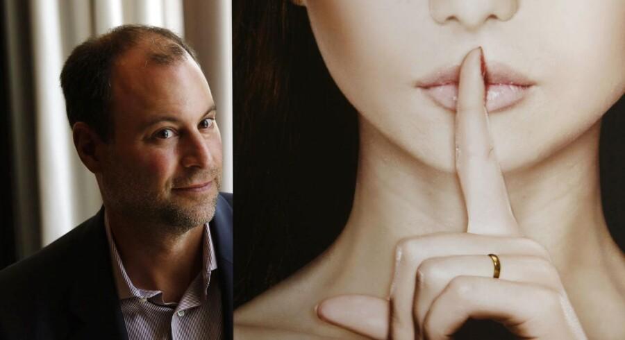 Ashley Madison-stifteren Noel Biderman poserer under et interview i Hong Kong.
