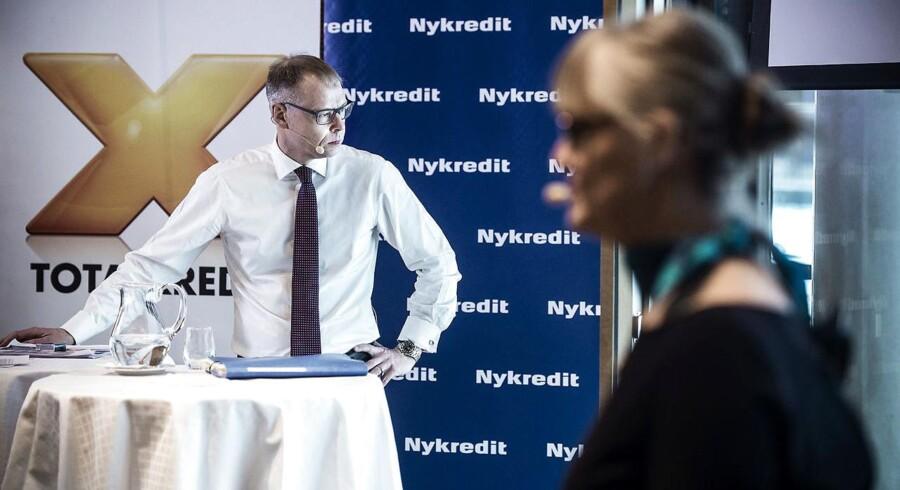 Michael Rasmussen, koncernchef i Nykredit fortæller om børsnoteringen på et pressemøde torsdag d. 4 februar 2016 i København sammen med formand for foreningen Nykredit Nina Smith