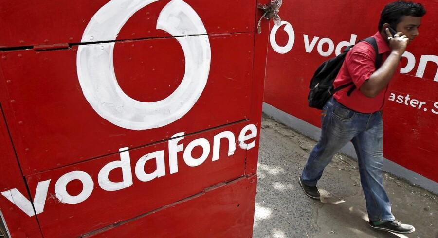 Det britiske teleselskab Vodafone kom ud af tredje kvartal med en udvikling i serviceindtægterne på linje med forventningerne.