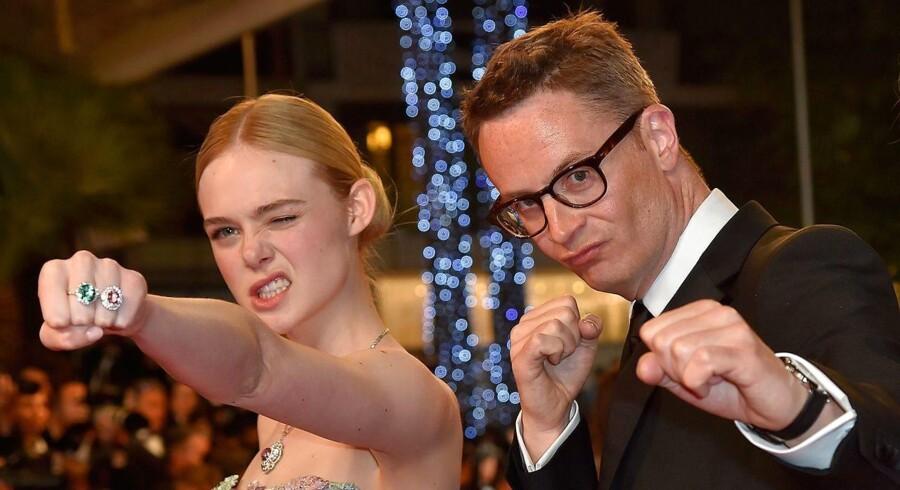 Den danske instruktør Nicolas Winding Refn (th) og skuespillerinden Elle Fanning i Cannes.