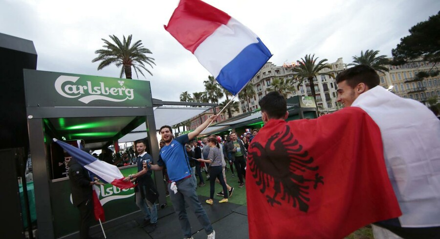 France and Albania fans gather in the fan zone near a bar that sells Carlsberg beer to watch the France v Albania EURO 2016 Group A soccer match, in Nice, France, June 15, 2016. REUTERS/Eric Gaillard