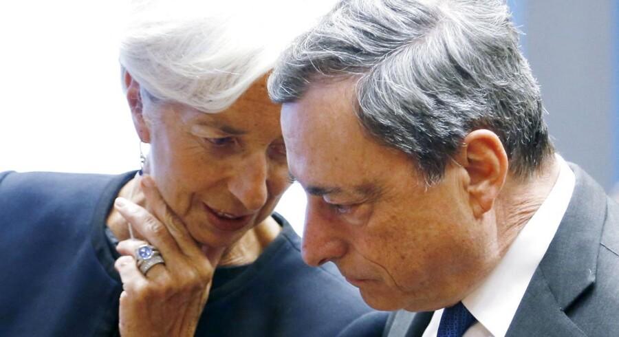 Christine Lagarde(IMF) i samtale med Mario Draghi(ECB).