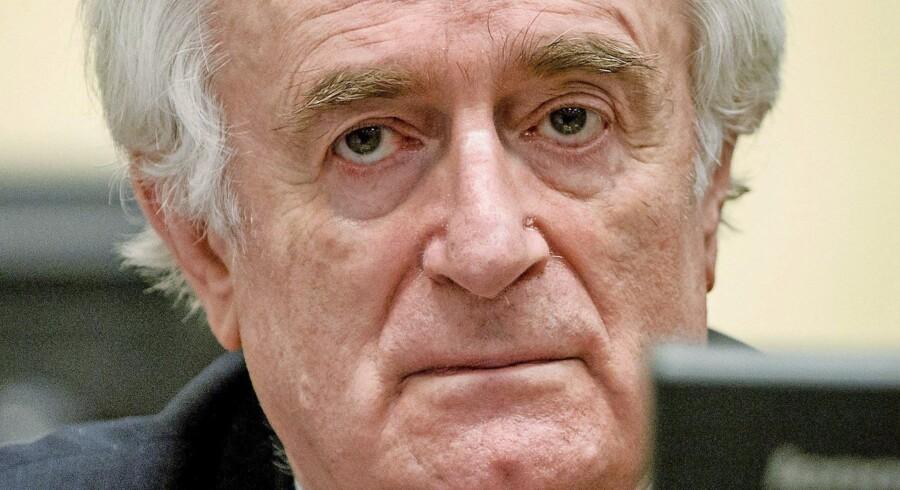 Skyldig! 70-årige Radovan Karadzic fik i går i Haag dommen over sine talrige forbrydelser mod menneskeheden under borgerkrigen i Bosnien i 1990erne: 40 års fængsel. Karadzic vil appellere dommen, siger han. Foto: Robin van Lonkhuijsen/EPA