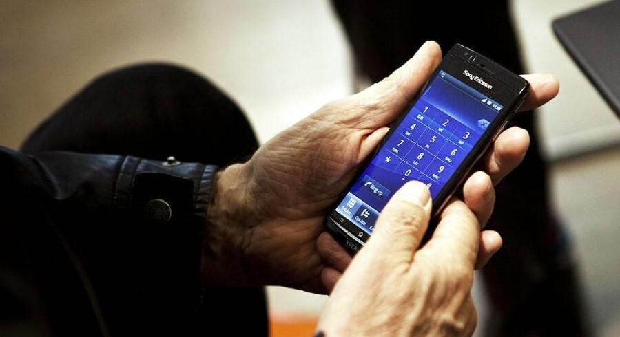 MobilePay bliver afprøvet som betalingsform i udvalgte butikker, men kunderne foretrækker dankortet.