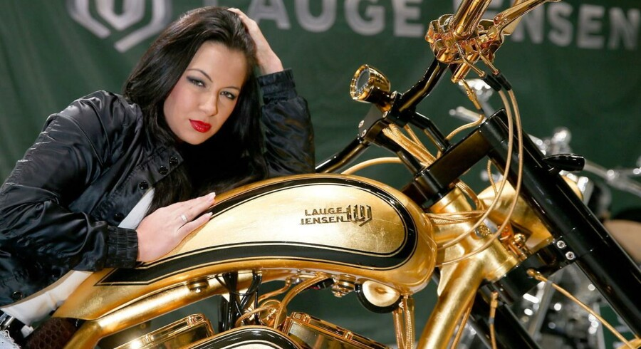epa04090734 Model Ramona poses with a gold-plated motorcycle worth 650, 000 euro by Danish motorcycle manufacturer Lauge Jensen at the expo center in Hamburg, Germany, 20 February 2014. The modified Harley Davidson is the world's most expensive motorcycle according to the producer. The Hamburg Motorcycle Days will take place from 21 to 23 February at the Hamburg Convention Center. EPA/AXEL HEIMKEN