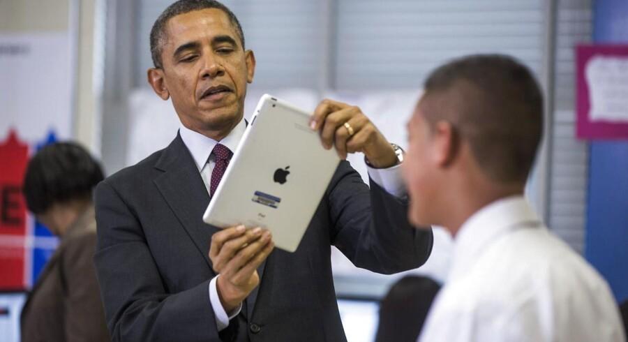 Selv om præsident Barack Obama selv har en iPad fra Apple, er der ingen kære mor: Apple skal betale fuld skat i USA. Arkivfoto: Jim Lo Scalzo, EPA/Scanpix