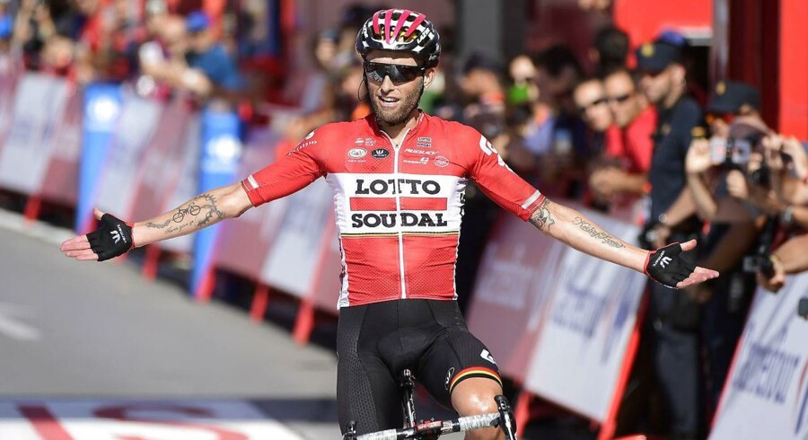 "Lotto Soudal's Belgian cyclist Tomasz Marczynski celebrates as he crosses the finish line of the 12th stage of the 72nd edition of ""La Vuelta"" Tour of Spain cycling race, a 160, 01 km race between Motril to Antequera, on August 31, 2017. / AFP PHOTO / JOSE JORDAN"