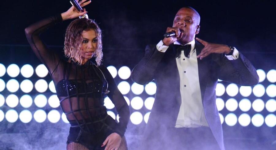 Sangeren Beyonce Knowles og hiphopstjernen Jay-Z underholder ved Grammy-uddelingen i Los Angeles i 2014. Jay-Z er i færd med at købe den norske musikstreamingtjeneste Wimp, men det går ikke helt så let som forventet. Arkivfoto: Frederic J. Brown, AFP/Scanpix