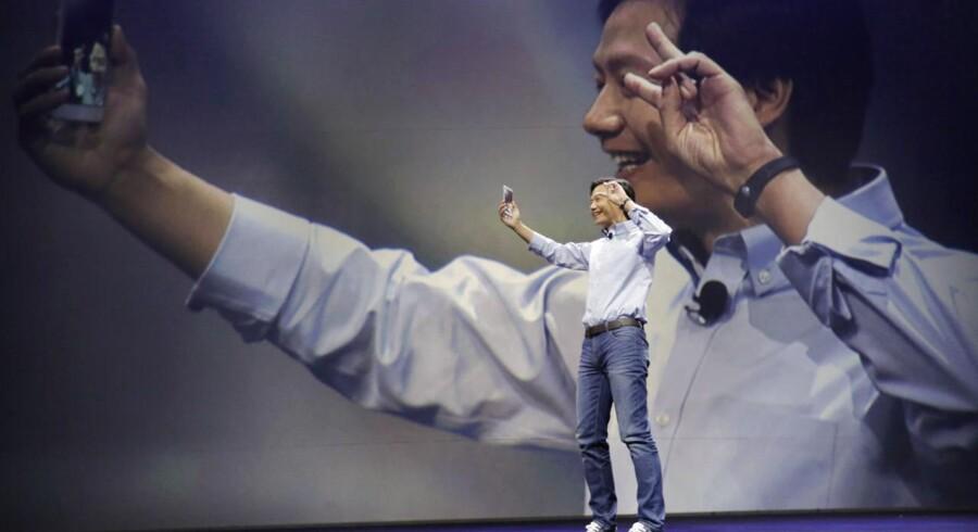 Lei Jun, der er blevet kaldt Kinas Steve Jobs, har som topchef for mobilgiganten Xiaomi købt sig ind i sit gamle firma, Kingsoft, der står bag den roste kontorpakke WPS Office. Foto: Jason Lee, Reuters/Scanpix
