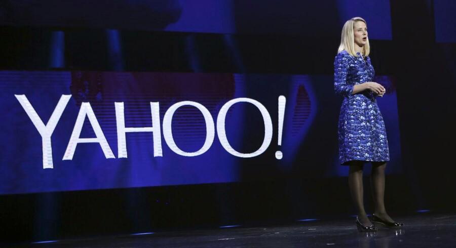 Internetgiganten Yahoo klarede sig lidt bedre end ventet i fjerde kvartal af 2014.