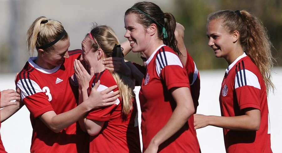 Denmark's forward Caroline Rask (2L) celebrates after scoring with Denmark's forward Frederikke Thogersen (R) and Denmark's midfielder Sofie Junge Pedersen (2R) during the Algarve Cup football match Portugal vs Denmark at the Estadio Municipal in Albufeira on March 9, 2015. AFP PHOTO / CRISTINA QUICLER